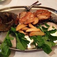 Photo taken at Sembol Fısh & Meat House by Yulia K. on 10/31/2014