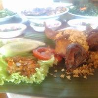 Photo taken at Telaga Seafood Restaurant by Nia R. on 10/19/2014