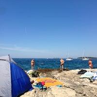 Photo taken at Beach Rovinj by Antonio L. on 8/17/2013