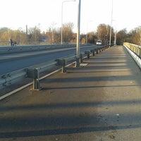 Photo taken at Buļļupes tilts by Ināra R. on 11/8/2013