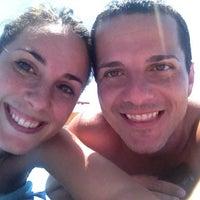 Photo taken at Corallo beach by Eliana A. on 6/25/2013