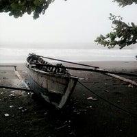 Photo taken at Pantai Gandoriah Pariaman by Edho K. on 10/19/2013