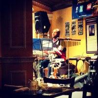 Photo taken at Ralph Brennan's Jazz Kitchen by Ahmed K. on 10/29/2012