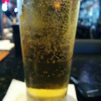 Photo taken at Knight Library Sports Bar & Grill by Nathan A. on 4/17/2015