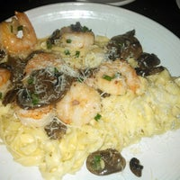Photo taken at Carrabba's Italian Grill by Rachel D. on 6/23/2013