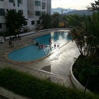 Photo taken at Swimming Pool Likas Square by Yayang Y. on 8/31/2014