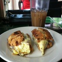 Photo taken at Olga's Cup + Saucer by Stephanie C. on 7/14/2013