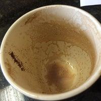 Photo taken at Bean Juice Coffee Roasters by Tim K. on 5/19/2014