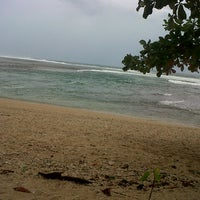 Photo taken at Pantai Ujung Genteng by Winda U. on 6/27/2013