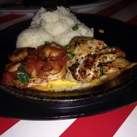 Photo taken at TGI Fridays by Marie M. on 12/23/2014
