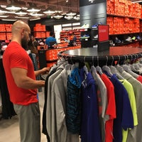Photo taken at Nike Factory Store by Ali Osman on 4/28/2016