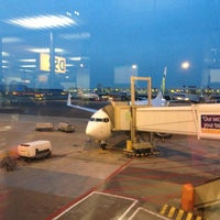 Photo taken at Gate D52 by Henk Y. on 4/8/2013