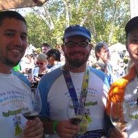 Photo taken at napa to sonoma wine country half marathon wine tent by Erin E. on 7/21/2013