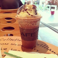 Photo taken at dr.CAFÉ Coffee by Tham R. on 2/20/2014