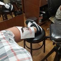 Photo taken at Mustafa Batur Tattoo by Uğur B. on 8/10/2013
