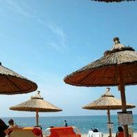 Photo taken at Mango Beach Bar by Panagiwta V. on 8/25/2013