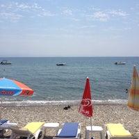 Photo taken at Raca Beach Club by Ayhan O. on 7/10/2013