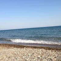Photo taken at Küçükkuyu Plajı by Mustafa M. on 6/25/2013