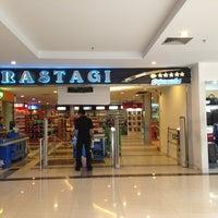 Photo taken at Brastagi Supermarket by Kelly G. on 7/3/2013