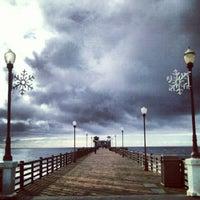 Photo taken at Oceanside Pier by Cesar V. on 12/13/2012