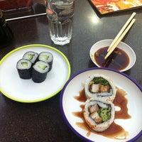 Photo taken at YO! Sushi by Emma V. on 7/21/2013