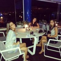 Photo taken at The Ritz-Carlton Bleu Lounge & Grill by Damla A. on 7/25/2013