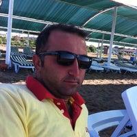 Photo taken at Kadriye Beach Park by Mehmet K. on 9/11/2014