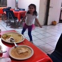 Photo taken at Mama Nena by Ruben C. on 11/25/2014