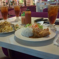 Photo taken at Solaria by Intan F. on 2/25/2014