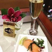Photo taken at Emirates Lounge by Nuttaya T. on 6/5/2015