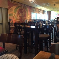 Photo taken at Tigín Irish Pub & Restaurant by Harown A. on 12/26/2015