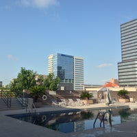 Photo taken at Hilton Rooftop Pool by Etsson P. on 7/13/2013