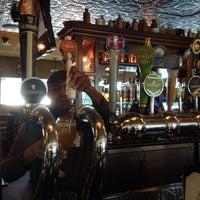 Photo taken at Tigín Irish Pub & Restaurant by Eric Y. on 2/6/2016