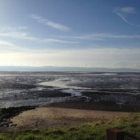 Photo taken at Caldy Beach by Sandra G. on 2/10/2014