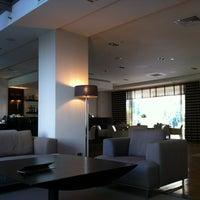 Photo taken at Galaxy Hotel by Ben C. on 7/26/2013