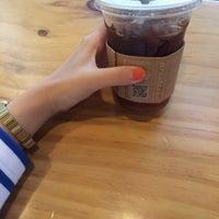Photo taken at Starbucks by EUNJI K. on 7/10/2014