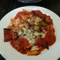 Photo taken at Gino's Pizzeria & Ristorante by Lindsey on 7/9/2013