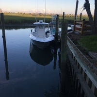 Photo taken at Murrell's Inlet Marshwalk by Ashley G. on 7/4/2018