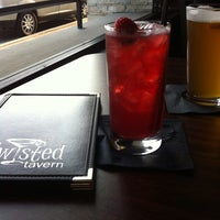 Photo taken at Twisted Tavern by Valerie R. on 8/8/2014