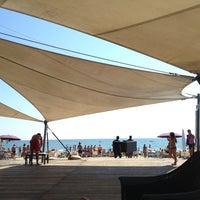 Photo taken at Corallo beach by Ennio R. on 7/27/2013