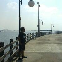 Photo taken at Pantai Indah by I Komang P. on 7/13/2015