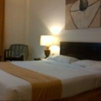 Photo taken at Grand Zuri Hotel by Aloycius Henry W. on 7/20/2013