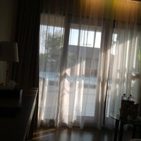 Photo taken at Grand Zuri Hotel by Aloycius Henry W. on 6/7/2014