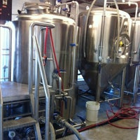 Photo taken at Port Jeff Brewing Company by Thomas N. on 7/4/2013