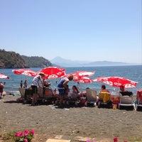 Photo taken at Inn Lice Beach Club by Savas U. on 8/10/2013