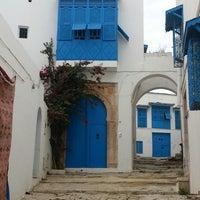 Photo taken at Sidi Bou Said by Jenny V. on 4/22/2014