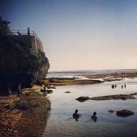 Photo taken at Suluban Beach by Kyu H. on 11/5/2013