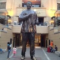 Photo taken at Nelson Mandela Square by Vishy B. on 9/15/2013