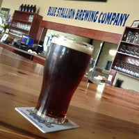 Photo taken at Blue Stallion Brewing Co. by Xavier D. on 7/21/2013