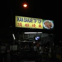 Photo taken at Tip Top Ikan Bakar Taman Muda by Johnson L. on 2/20/2013